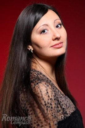 Ukrainian girl Lena,28 years old with brown eyes and dark brown hair.