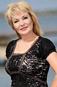 Ukrainian girl Liliya,51 years old with hazel eyes and blonde hair.