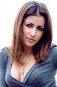 Ukrainian girl Elena,31 years old with brown eyes and dark brown hair.