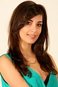 Ukrainian girl Yana,23 years old with hazel eyes and dark brown hair.