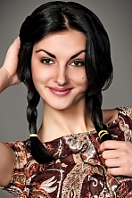 Ukrainian girl Anna,22 years old with brown eyes and black hair.