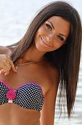 Ukrainian girl Anastasia,21 years old with green eyes and dark brown hair.