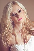 Ukrainian girl Olesia,25 years old with green eyes and blonde hair.