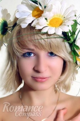 Ukrainian girl Victoria,30 years old with blue eyes and blonde hair.