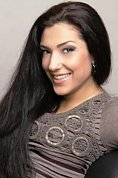 Ukrainian girl Tatiana,25 years old with brown eyes and black hair.