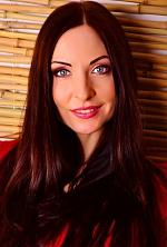 Ukrainian girl Karina,32 years old with grey eyes and dark brown hair.