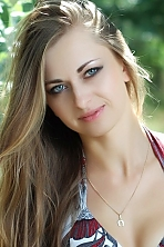 Ukrainian girl Lyudmila,28 years old with grey eyes and light brown hair.