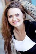 Ukrainian girl Tatyana,31 years old with blue eyes and dark brown hair.