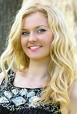 Ukrainian girl Elena,26 years old with grey eyes and blonde hair.
