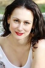 Ukrainian girl Liliya,34 years old with green eyes and light brown hair.