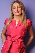 Ukrainian girl Tatiyana,47 years old with brown eyes and blonde hair.