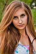 Ukrainian girl Olga,23 years old with blue eyes and light brown hair.