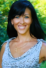 Ukrainian girl Elena,38 years old with grey eyes and black hair.