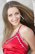 Ukrainian girl Alena,27 years old with green eyes and auburn hair.