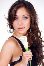 Ukrainian girl Kristina,25 years old with blue eyes and dark brown hair.