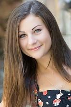 Ukrainian girl Juliana,26 years old with grey eyes and dark brown hair.
