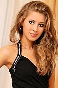 Ukrainian girl Oksana,25 years old with grey eyes and blonde hair.