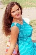 Ukrainian girl Alla,31 years old with blue eyes and black hair.