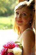 Ukrainian girl Tatiana,36 years old with blue eyes and blonde hair.