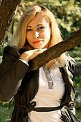 Ukrainian girl Anzhela,47 years old with grey eyes and blonde hair.