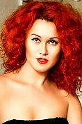 Ukrainian girl Diana,26 years old with grey eyes and red hair.