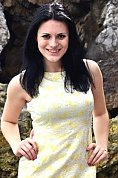 Ukrainian girl Olga ,21 years old with green eyes and black hair.