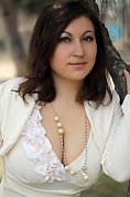 Ukrainian girl Alena,30 years old with green eyes and dark brown hair.