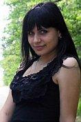 Ukrainian girl Tatiana,22 years old with hazel eyes and black hair.