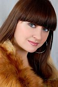 Ukrainian girl Tatiana,22 years old with blue eyes and black hair.