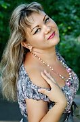 Ukrainian girl Elena,35 years old with blue eyes and blonde hair.