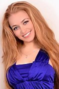 Ukrainian girl Julia,25 years old with blue eyes and light brown hair.