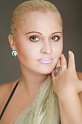 Ukrainian girl Valentina,37 years old with green eyes and blonde hair.