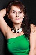 Ukrainian girl Elena,39 years old with brown eyes and dark brown hair.