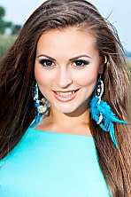 Ukrainian girl Svetlana,25 years old with hazel eyes and light brown hair.