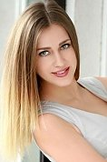 Ukrainian girl Marina,31 years old with green eyes and light brown hair.
