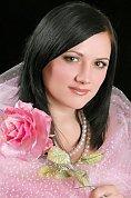 Ukrainian girl Angelina,31 years old with brown eyes and dark brown hair.