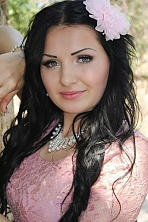 Ukrainian girl Galina,24 years old with grey eyes and black hair.