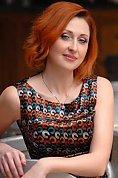 Ukrainian girl Oksana,38 years old with blue eyes and light brown hair.