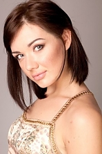 Ukrainian girl Tatiana,25 years old with green eyes and dark brown hair.