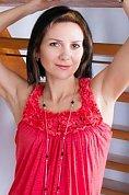 Ukrainian girl Olga,43 years old with green eyes and black hair.
