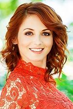 Ukrainian girl Elena,36 years old with brown eyes and dark brown hair.