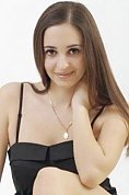 Ukrainian girl Anna,20 years old with hazel eyes and auburn hair.