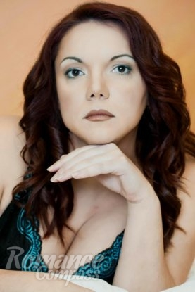 Ukrainian girl Tatiana,38 years old with brown eyes and red hair.