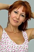 Ukrainian girl Lilia,38 years old with brown eyes and red hair.