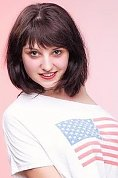 Ukrainian girl Yulia,20 years old with green eyes and dark brown hair.