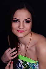 Ukrainian girl Yuliya,22 years old with brown eyes and dark brown hair.