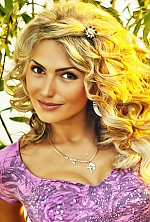 Ukrainian girl Julia,24 years old with hazel eyes and blonde hair.