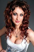 Ukrainian girl Maya,25 years old with blue eyes and dark brown hair.