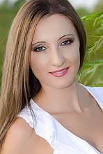 Ukrainian girl Elena,25 years old with grey eyes and light brown hair.