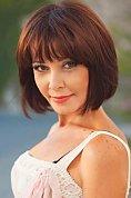 Ukrainian girl Victoria,53 years old with brown eyes and dark brown hair.